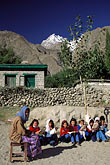 young boy and girl stock photography | Pakistan, Karakoram Highway, Schoolteacher and class, Gulmit, Hunza, image id 4-444-13
