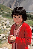 vertical stock photography | Pakistan, Karakoram Highway, Young girl in field, Gulmit, Hunza, image id 4-448-30