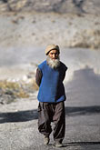 vertical stock photography | Pakistan, Karakoram Highway, Man walking on the road near Gilgit, image id 4-463-8
