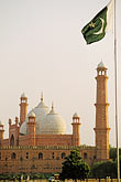 vertical stock photography | Pakistan, Lahore, Badshahi Mosque and Pakistan flag, image id 4-475-1