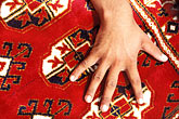 coverings stock photography | Pakistan, Woven Carpet and hand, image id 4-480-33