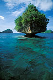 sea stock photography | Palau, Rock Islands, Forested island, image id 8-87-15