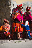 hispanic stock photography | Peru, Ollantaytambo, Quechua woman and children in traditional clothing, standing in marketplace, image id 8-760-1001