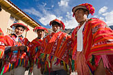 horizontal stock photography | Peru, Ollantaytambo, Quechua men in traditional clothing, standing in marketplace, low angle view, image id 8-760-1023