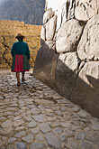 andes stock photography | Peru, Ollantaytambo, Quechua woman with bowler hat, walking on stone pavement, silhouette, image id 8-760-1077