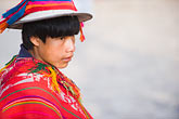horizontal stock photography | Peru, Ollantaytambo, Young Quechua boy in traditional clothing and hat, with red coven cloth, side view, image id 8-760-1182