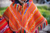 horizontal stock photography | Peru, Ollantaytambo, Traditional Quechua red woven cloth poncho, image id 8-760-1236