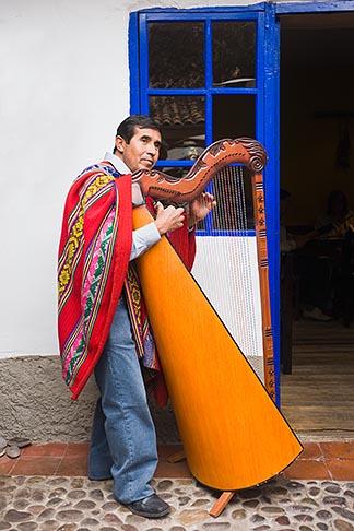 image 8-760-622 Peru, Cuzco, Man playing Andean Harp, standing