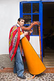 latin america stock photography | Peru, Cuzco, Man playing Andean Harp, standing, image id 8-760-622