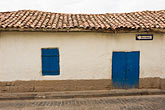 whitewashed building stock photography | Peru, Cuzco, Red-tiled building with whitewashed walls and shuttered blue door, image id 8-760-742