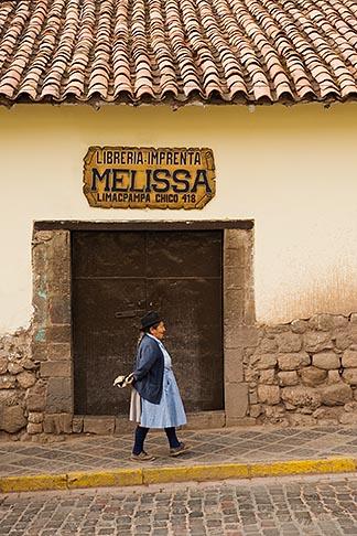 image 8-760-769 Peru, Cuzco, Quechua woman walking outside shop