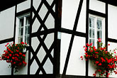 red flower stock photography | Poland, Jelenia Gora, Timbered house, image id 4-960-1240