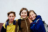 three people only stock photography | Poland, Jelenia Gora, Young children after school, image id 4-960-1316
