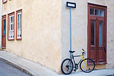 arrow sign stock photography | Canada, Quebec City, Bicycle outside house, Old Quarter, image id 5-750-394