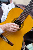 man playing guitar stock photography | Canada, Quebec City, F�tes de la Nouvelle France, Musician, image id 5-750-8542