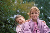 together stock photography | Russia, Vladivostok, Young girls playing on statue, image id 2-753-22