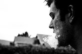 horizontal stock photography | Portraits, Man smoking, image id S1-50-1