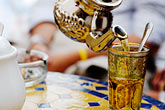 glass stock photography | Spain, Trabuco, Pouring tea, image id S5-125-8269
