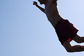 blue sky stock photography | Spain, Nerja, Man Jumping, image id S5-125-8624