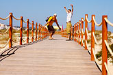 man on beach stock photography | Portugal, Lagos, Men on boardwalk, image id S5-128-9391