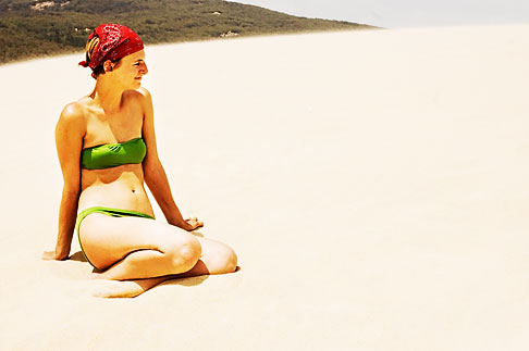 image S5-128-9723 Spain, Bolonia, woman sitting on sand dune