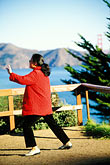 image 3-1011-62 California, San Francisco, GGNRA, Lands End, Woman practising Tai Chi