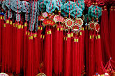 red tassles at souvenir stand stock photography | China, Red tassles at souvenir stand, image id 7-620-3510