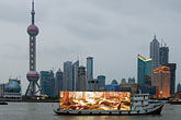 illuminated stock photography | China, Shanghai, Pudong skyline with Hunagpu riverboat, image id 7-620-3555