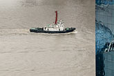 different stock photography | China, Shanghai, Tug on Huangpu River, from above, with office building, image id 7-620-3652