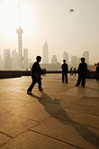 vertical stock photography | China, Shanghai, Morning Tai Chi, Bund Promenade, image id 7-620-3920