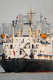 vertical stock photography | China, Shanghai, Freighter on the Huangpu River, image id 7-620-4157