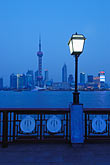 pudong skyline at night stock photography | China, Shanghai, Pudong skyline and the Bund Promenade at night, image id 7-620-4172