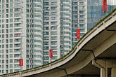 apartment buildings and elevated motorway stock photography | China, Shanghai, Apartment buildings and elevated motorway, image id 7-620-4253