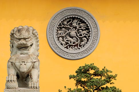 image 7-620-4830 China, Shanghai, Longhua Temple, stone lion, window decoration and pine tree