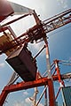 crane stock photography | Japan, Yokohama, Container crane lifting shipping container, low angle view, image id 7-675-7979