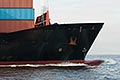 trade stock photography | Shipping, Stacked containers on bow of container ship , image id 7-675-8482