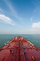 trade stock photography | Shipping, Deck of oil tanker, pipes and valves, with bow and blue sky, image id 7-677-9089