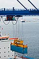trade stock photography | Shipping, Container being lifted by crane onto container ship, image id 7-678-5944