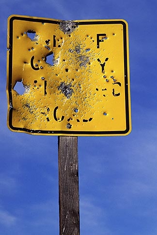 image 2-180-21 Sign, Target practice on road sign
