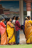 woman stock photography | Singapore, Sri Mariamman Temple, Men and woman waiting for blessing, image id 7-680-4352