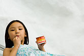 horizontal stock photography | Singapore, Young girl eating icecream, image id 7-680-4514