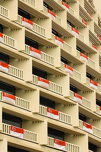 image 7-680-4567 Singapore, Hotel balconies draped with Singapore flag