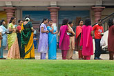 horizontal stock photography | Singapore, Sri Mariamman Temple, Men and woman waiting for blessing, image id 7-680-8681