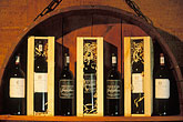 glass stock photography | South Africa, Stellenbosch, Wine bottles in cellar, Delheim Winery, image id 1-410-92