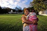 smiling woman stock photography | South Africa, Stellenbosch, Xhosa Mother with child, image id 1-422-46