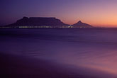 mountain stock photography | South Africa, Western Cape, Table Mountain at dusk from Bloubergstrand, image id 5-475-17