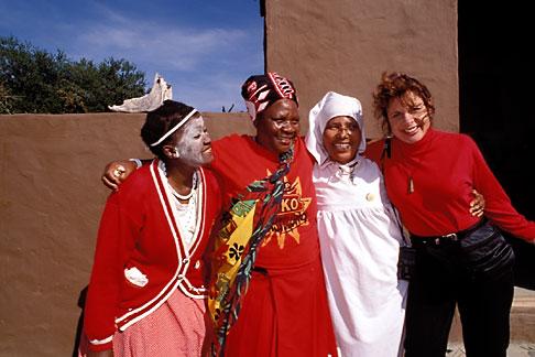 image 7-442-9 South Africa, Eastern Cape, Zulu women and visitor, Kaya Lendaba