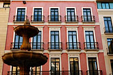 window stock photography | Spain, Malaga, Building and Fountain, image id S4-531-9118
