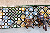 read stock photography | Spain, Granada, Reading guidebook, Palacio Nazaries, The Alhambra, image id S4-540-9805