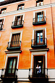 building stock photography | Spain, Madrid, Man on balcony, image id S4-545-884